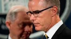 Andrew McCabe, then acting FBI director, with Jeff