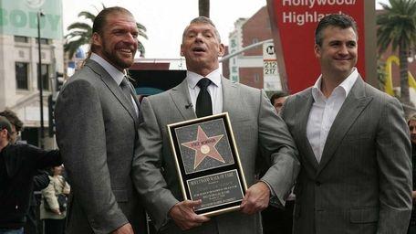 Wrestling superstar Triple H, left, and Shane McMahon,