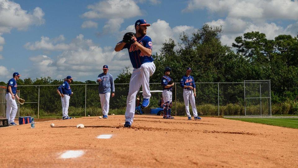 New York Mets pitcher Zach Wheeler throws a