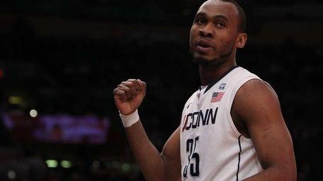 UConn's Charles Okwandu celebrates a basket against DePaul