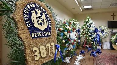 Flowers for the wake of NYPD Det. Brian