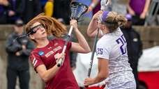 James Madison's Haley Warden, right, and Boston College's