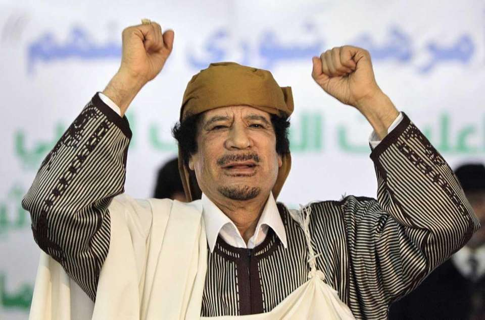 Libyan Leader Moammar Gadhafi gestures to supporters as