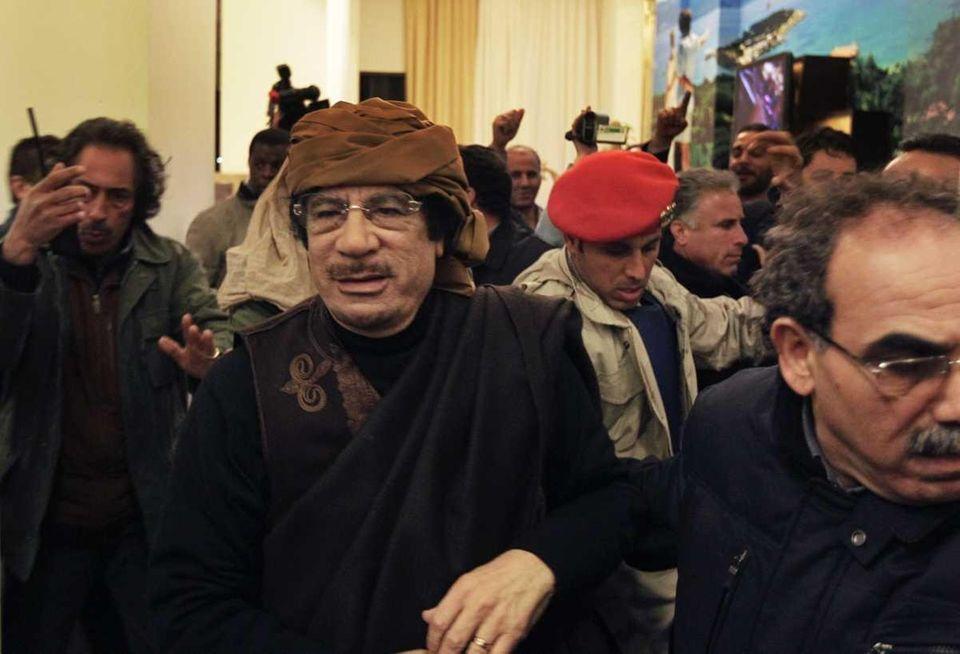 Libyan leader Moammar Gadhafi arrives at a hotel