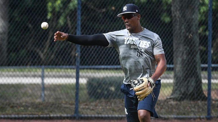 Yankees third baseman Miguel Andujar takes infield drills