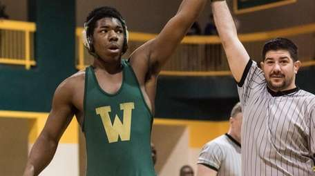 Westbury's Jeremiah Funchess wins the 220-pound semifinal against