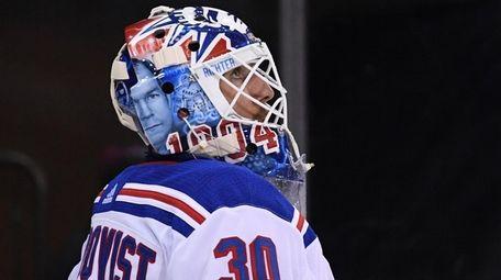 Rangers goaltender Henrik Lundqvist wears a helmet with