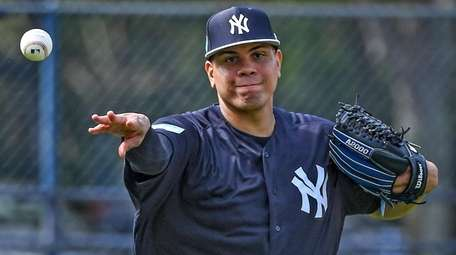 Yankees pitchers Dellin Betances takes infield drills during