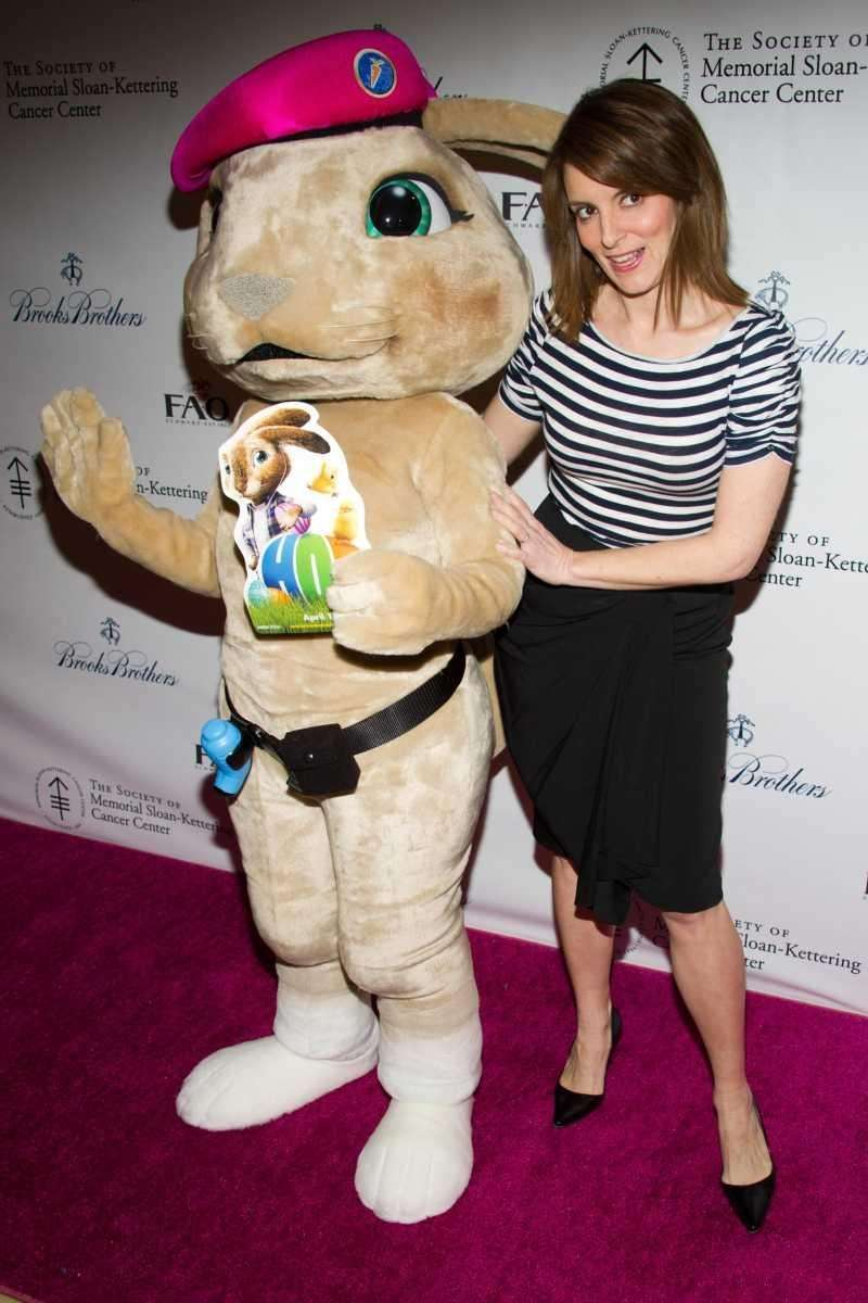 Tina Fey poses with a costumed bunny character
