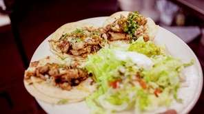 Traditional, Mexican soft chicken tacos were served at