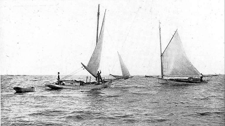 Shellfishermen work the Great South Bay from catboats