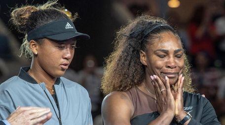 Naomi Osaka of JPN standing next to Serena