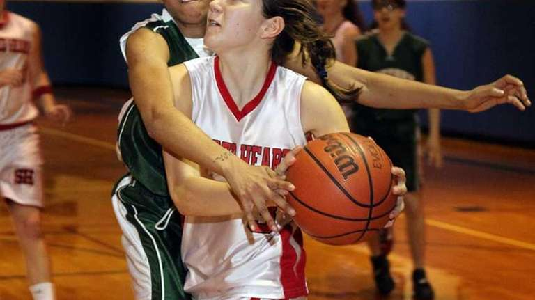 Sacred Heart's Nina Corcoran (3) drives the baseline