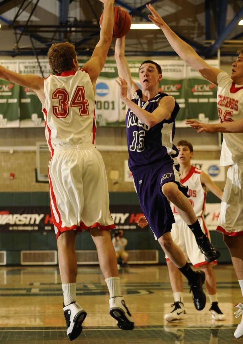 Port Jefferson's Braden Colucci drives to the basket