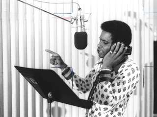 Groundbreaking country music star Charley Pride recording