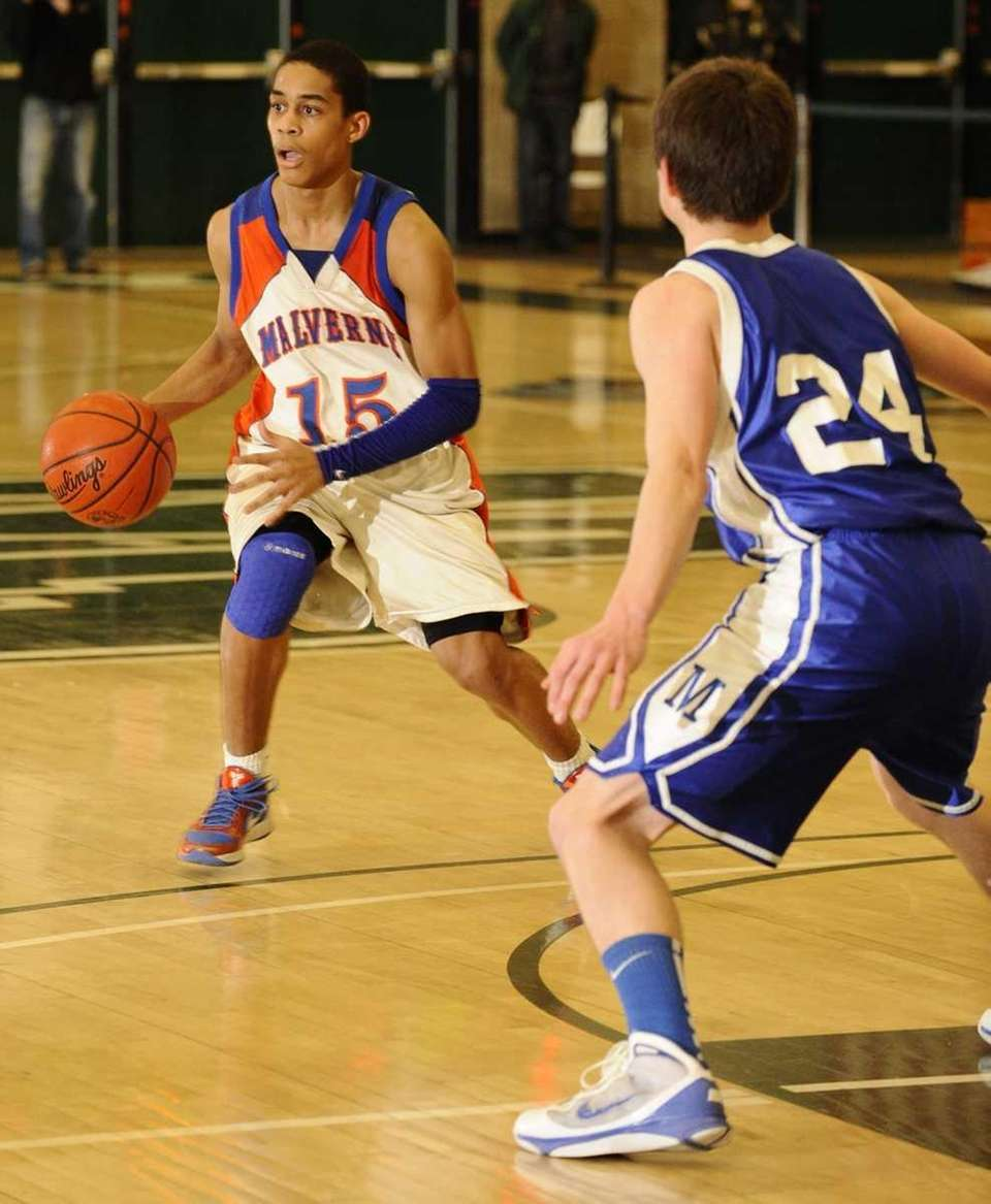 Malverne's Xzvier Bernard controls the ball guarded by