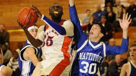 Malverne's Anthony Moultrie goes for two points in