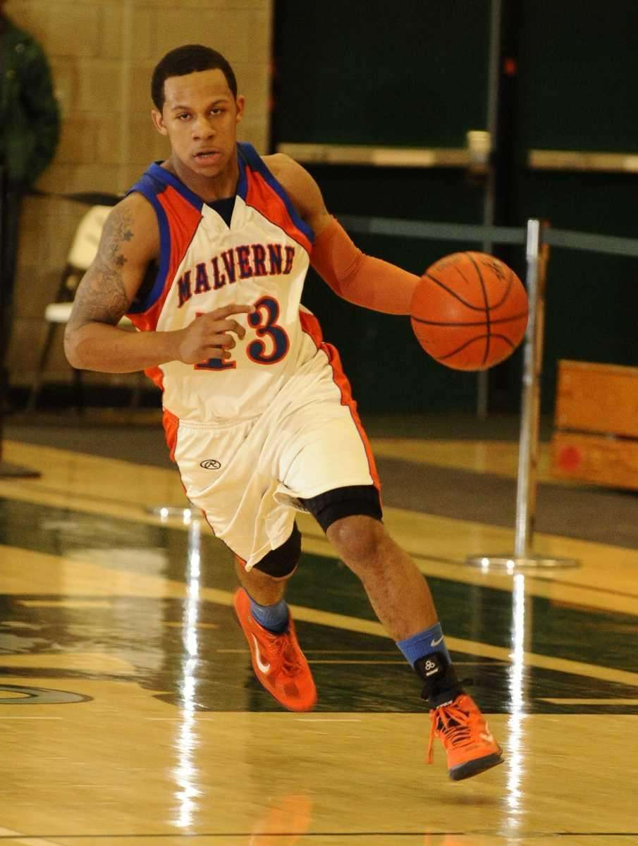 Malverne's Cory Alexander drives the ball downcourt against