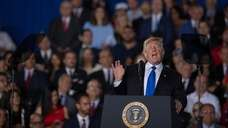 President Donald Trump speaks during an event with