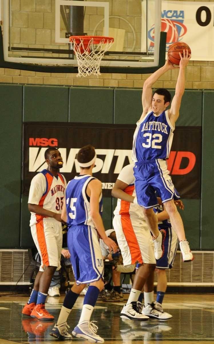Mattituck's Yianni Rauseo pulls down a rebound against