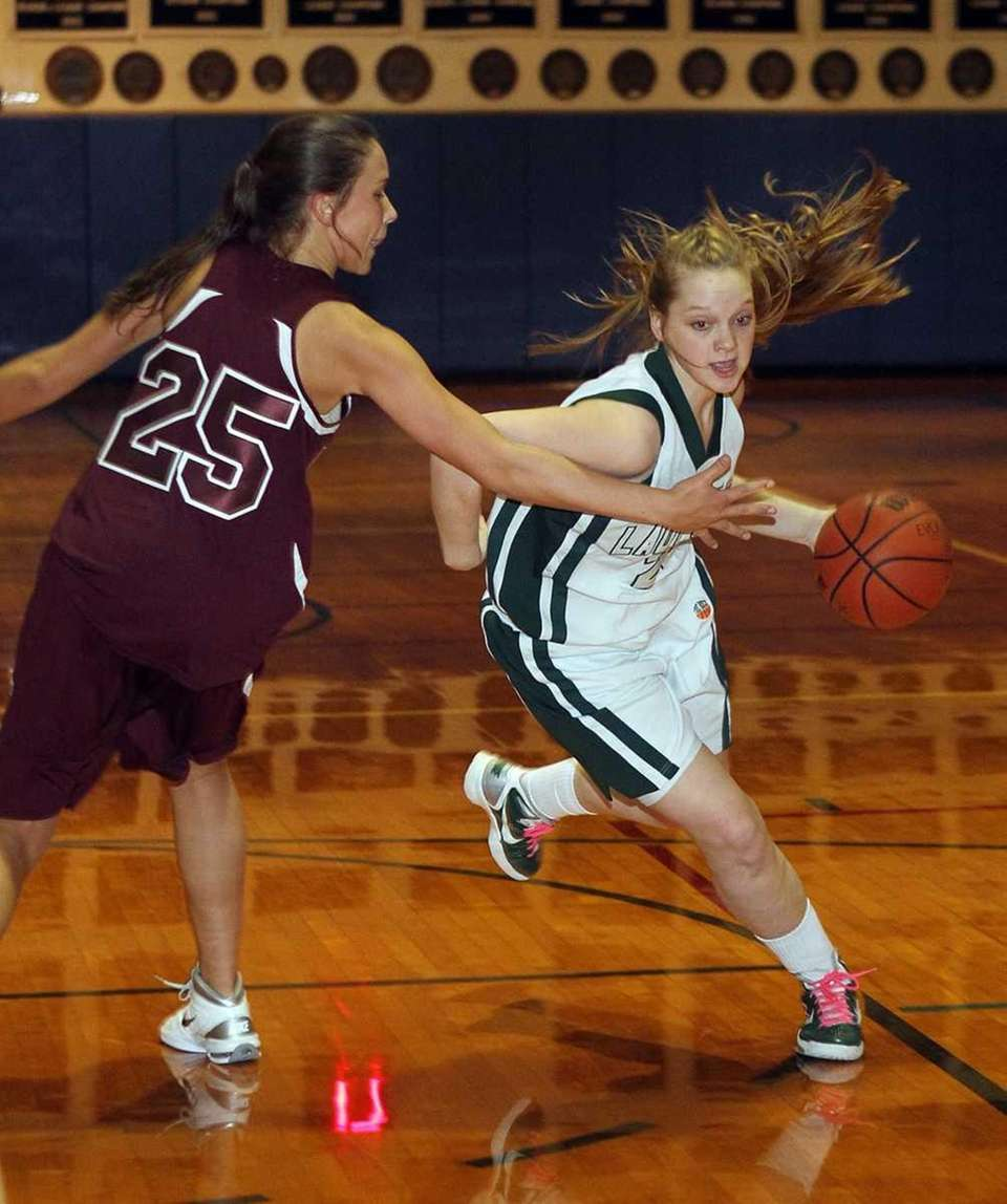 Holy Trinity's Katherine Poppe (23) drives into the