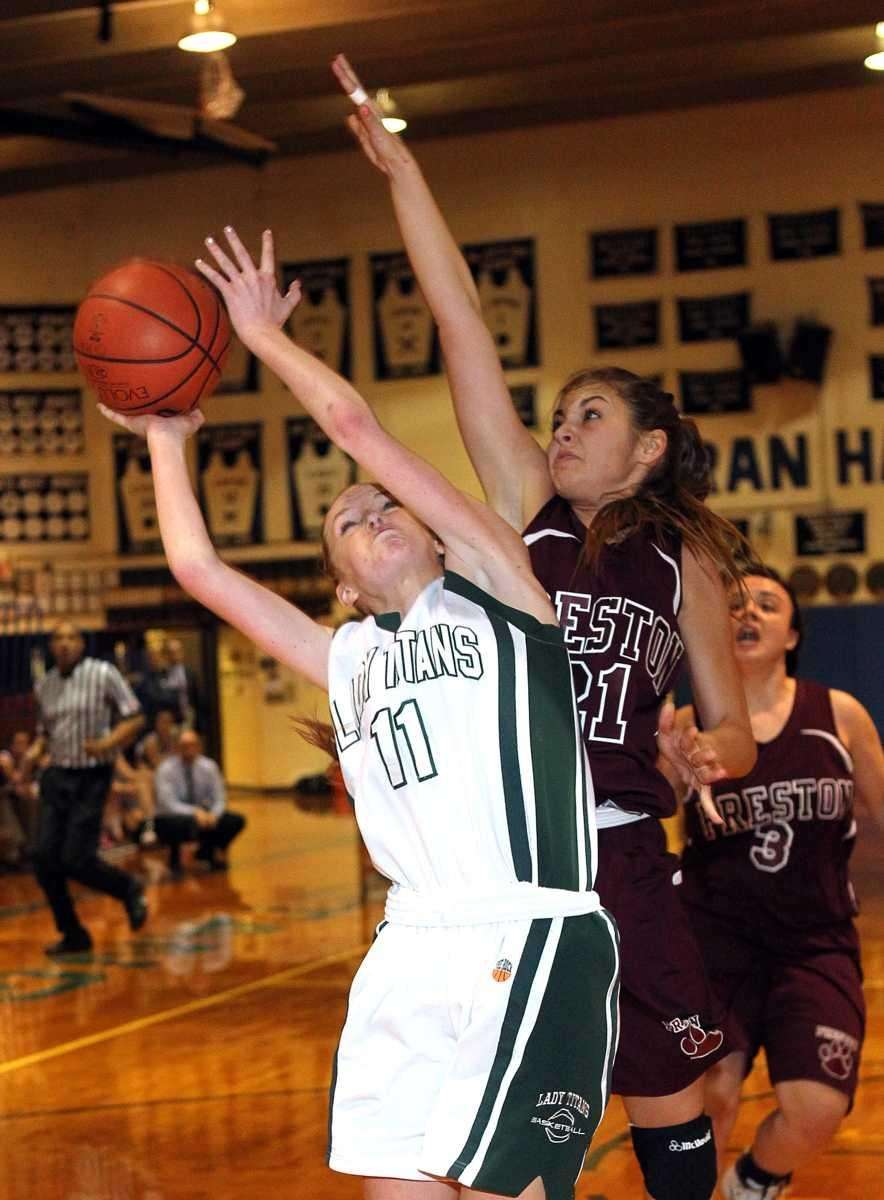 Holy Trinity's Kelly Carey (11) is fouled going