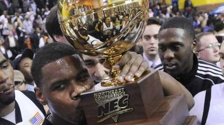 Long Island's Kyle Johnson kisses the trophy after