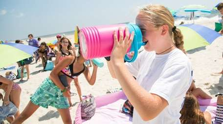 Taylor Essex of West Islip, 12, stays hydrated