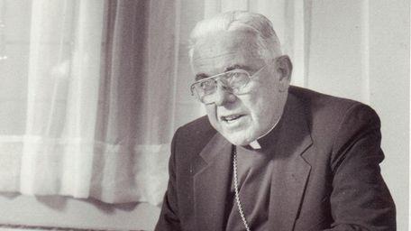Bishop John McGann sits for an interview at