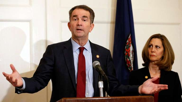 Virginia Gov. Ralph Northam, left, accompanied by his