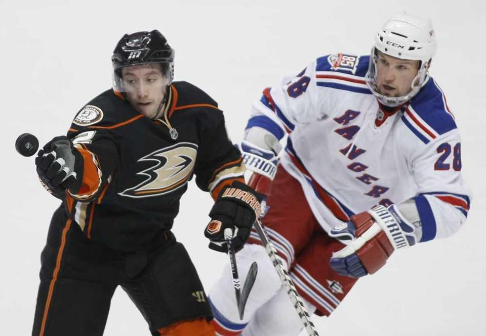 Anaheim's Dan Sexton, left, and Rangers defenseman Bryan