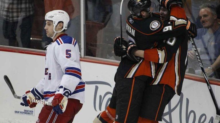 Rangers defenseman Dan Girardi (5) skates by as