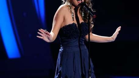 Hayley Reinhart sings in front of the judges
