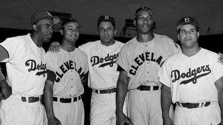 From left, Brooklyn Dodgers' Jackie Robinson, Cleveland Indians
