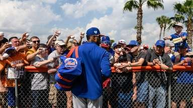 The  Mets' Robinson Cano signs autographs during