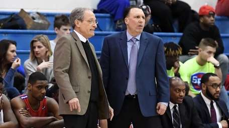 Ron Ganulin, left, men's assistant coach, and Glenn