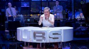 Bryan Cranston stars as newsman Howard Beale in
