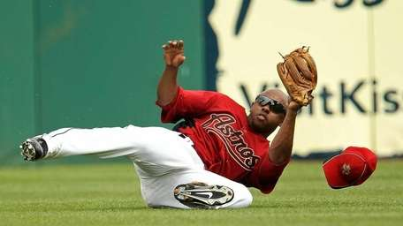 Houston's Jason Bourgeois makes a sliding catch against