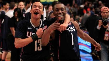 UConn's Shabazz Napier, left, and Kemba Walker celebrate