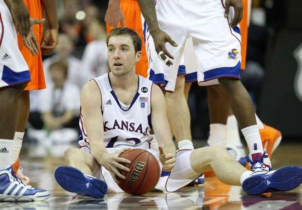 Kansas' Brady Morningstar sits on the court after