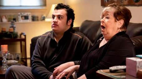 Mary DeFazio, right, and her grandson, Giancarlo, react