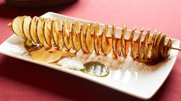"""Toofani aloo, """"stormy potato,"""" is a spiralized, French-fried"""