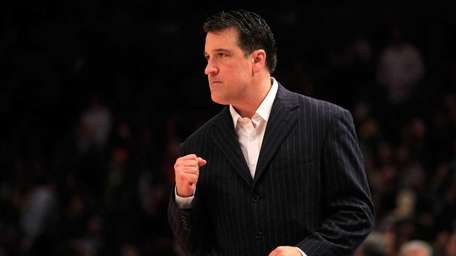 St. John's head coach Steve Lavin reacts from