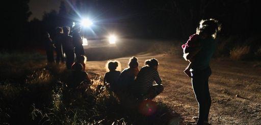 U.S. Border Patrol agents arrive to detain a