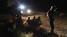 U.S. Border Patrol agents arrive to detain a