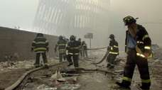 New York City firefighters work amid debris on