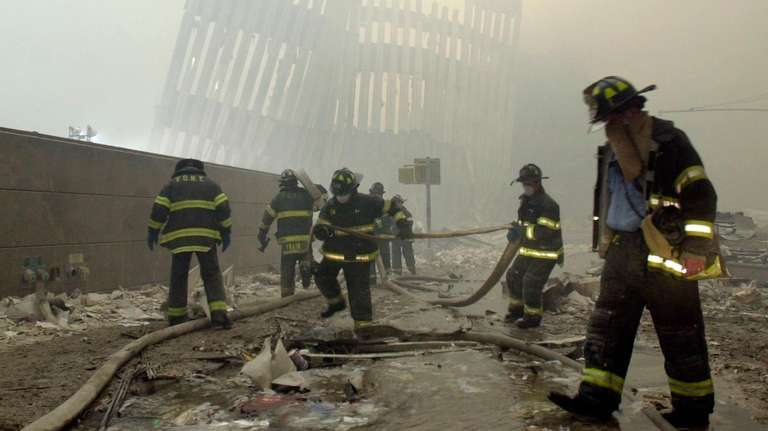New York City firefighters work amid debris on