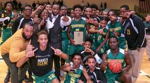 Wyandanch players and coaches celebrate with the winning