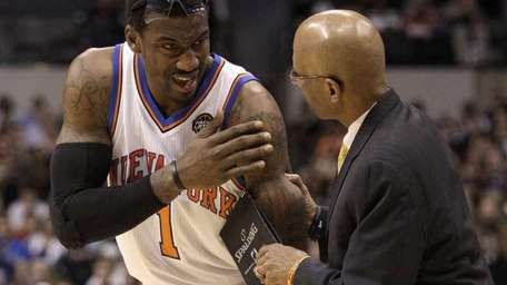 New York Knicks' Amare Stoudemire (1) receives assistance