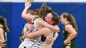 Northport players celebrate their 61-56 win against Ward